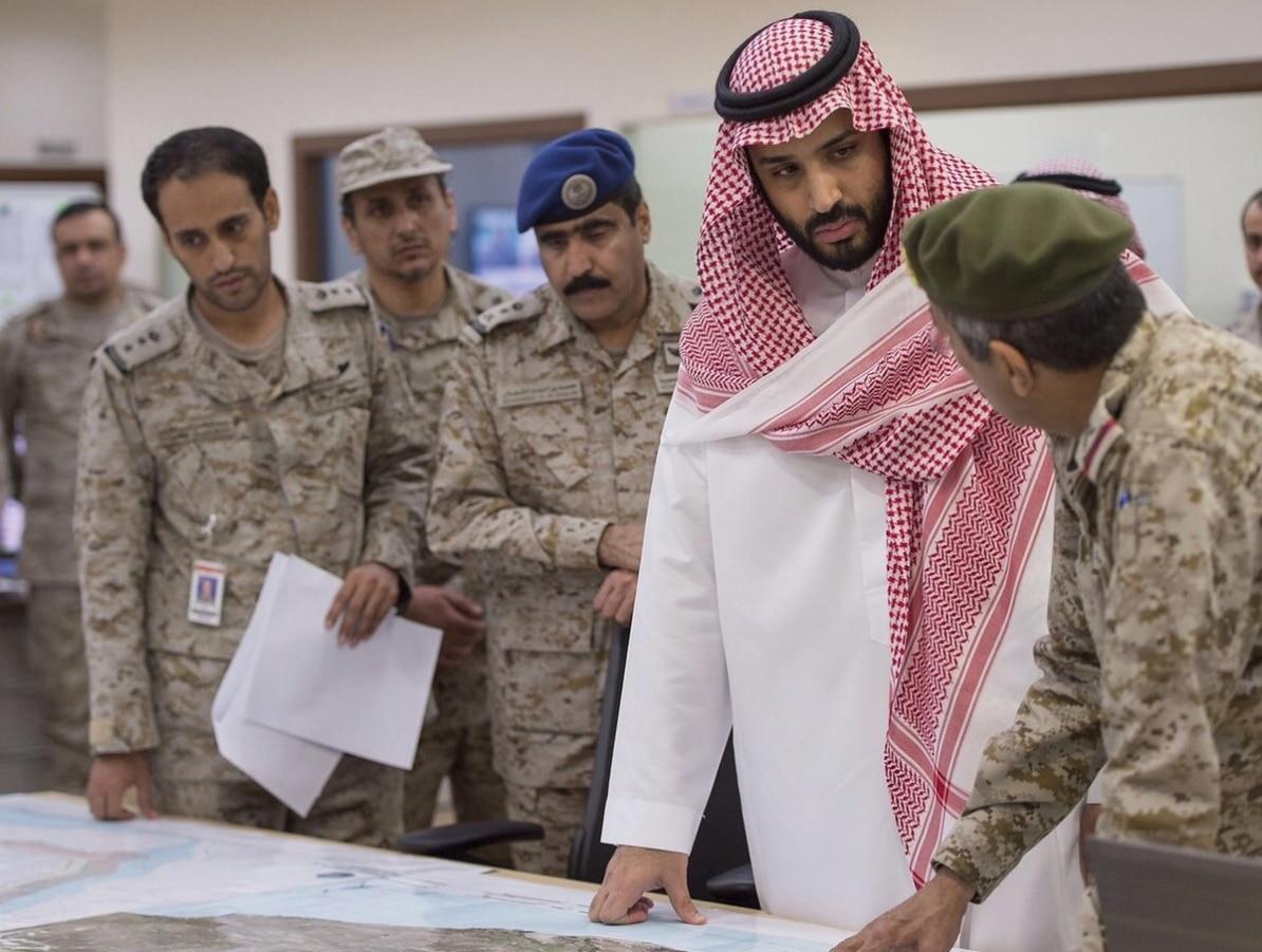 Mohammad Bin Salman Al Saud et al. standing around each other