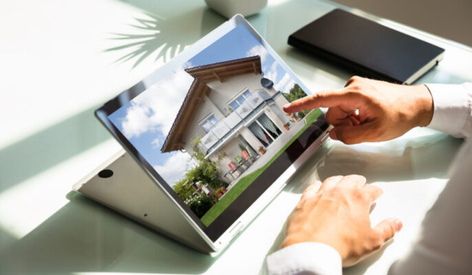 A man seeing home images in laptop