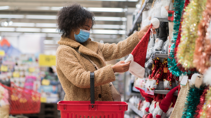 A girl wearing a mask and hold the basket in shop